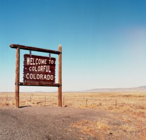 Welcome to Colorful Colorado sign next to highway